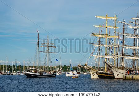 Sailing ships on the river Warnow in Rostock Germany.