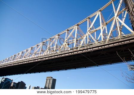 A part of Queensboro bridge with clearly blue sky