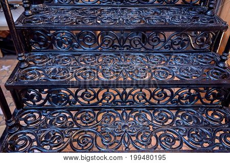 Closeup image of beautiful retro forged iron staircase
