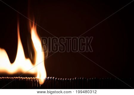 Lots Of Matchsticks Burning With A Domino Effect, Black Background
