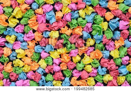 Red, green, blue, yellow and orange crumpled papers background