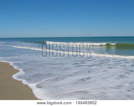 Sea Foam waves rolling in at Myrtle Beach