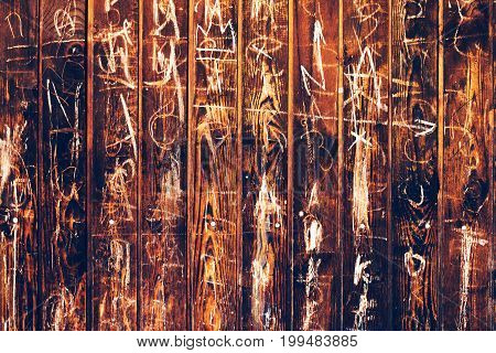 Random chalk scribble on wooden surface abstract background