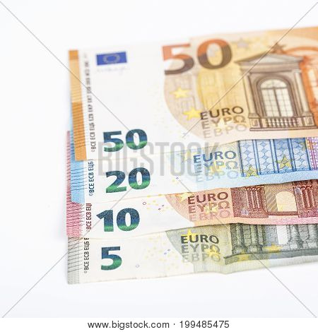 European union currency euro banknotes bills background. 510 20 and 50 euro. Concept success rich economy. On white background Europe