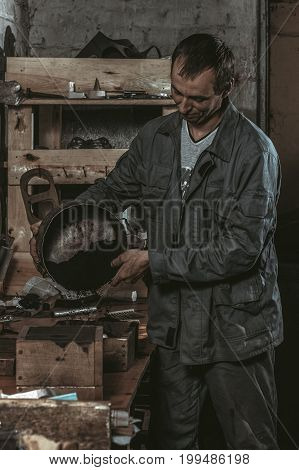 Worker strews the working mixture into a form