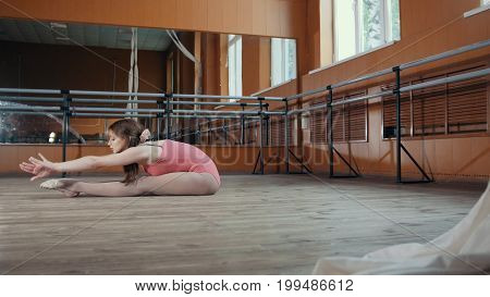 Young pretty girl demonstrates the flexibility of her body, circus artist