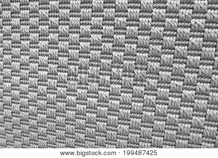 Textile Texture Close Up of Gray Weaving Fabric Pattern Background with Copy Space for Text Decoration.