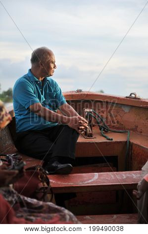 Serious boat man in old age looking away