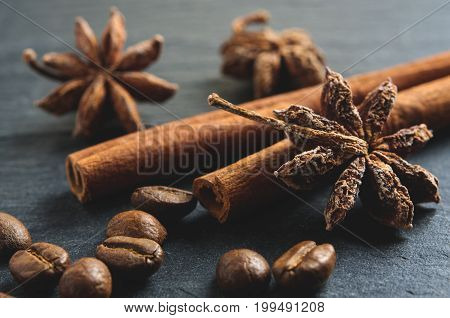 Brown ingredients macro: anise star, cinnamon sticks and coffee beans