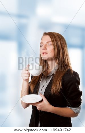 Attractive business woman to inhale aroma coffee