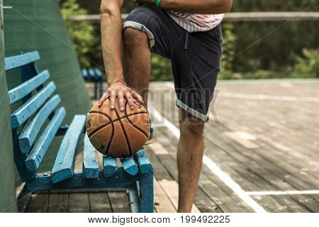 a young man with a basketball on the court the concept of sport