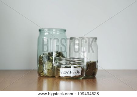 Coins In Glass Jars For Different Needs