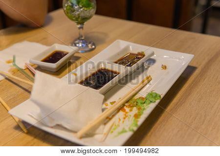 Empty Dirty Plate Of Sushi On Table In Cafe.