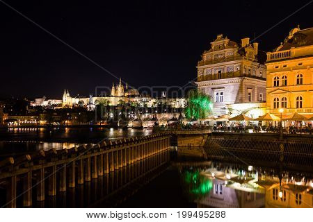 Prague sunset view of the Old Town architecture and Charles bridge over Vltava river, Czech Republic.