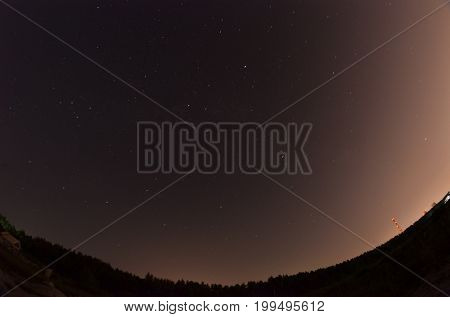 Star trails and light pollution near big city.Kiev region