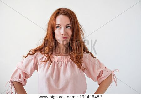Portrait of young tender redhead woman with healthy freckled skin thinging about problems. Try to find right desicion