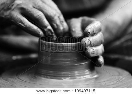 Potter Making Ceramic Pot On The Pottery Wheel