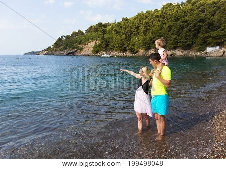 Family of 3 people on vacation by the sea