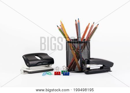 Colored pencils in a case on white background.