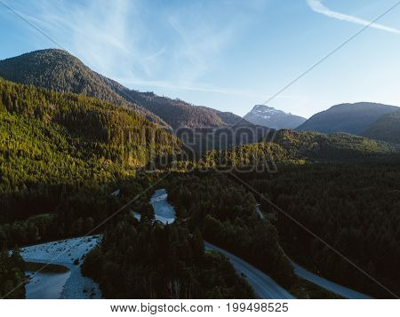 Aerial Shot Of Road In Valley While Sunset Behind Mountain