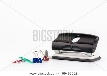 Paper puncher isolated on white Business and education fbackground
