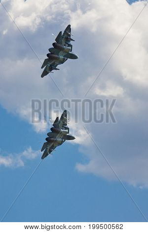 VORONEZH, RUSSIA - MAY 25, 2014: Two new Russian fighters of the fifth generation T-50 shows demonstration flight above Voronezh airfield Baltimore
