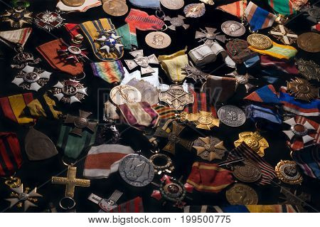 Old retro military orders and medals on a black background. Background of old retro military awards and war medals.