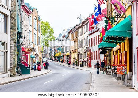 Quebec City Canada - May 29 2017: Saint Louis street by restaurants in old town with shops and road