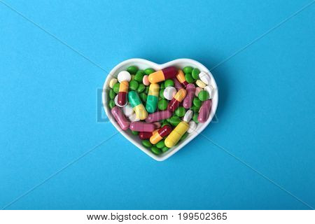 colorful assortment pills and capsules on plate