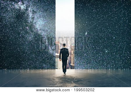 Back view of young businessman walking towards abstract opening with city view in abstract space starry sky room. Forward creativity concept