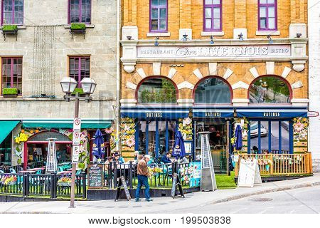 Quebec City Canada - May 29 2017: Old town Saint Jean street with restaurant Chez Livernois Bistro and people walking