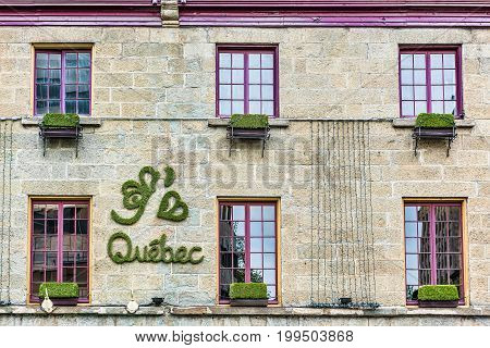 Quebec City Canada - May 29 2017: J'aime Quebec sign on wall in green grass lettering with heart