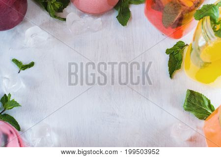 Copy space with fresh fruit drinks around. Recipes, inscription for web sites, cafe and restaurant menu, background, close up picture