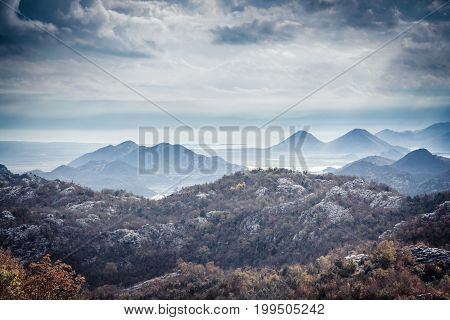 Mountains landscape with mountains peaks on sea coast  with dramatic sky in overcast day with mist in Europe country Montenegro