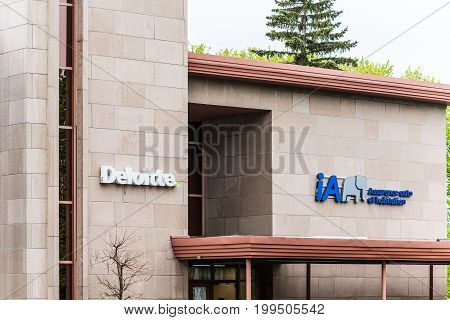 Quebec City Canada - May 30 2017: Deloitte office sign on building with Assurance auto et habitation