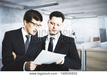Handsome businessmen discussing contract in modern office. Teamwork concept. 3D Rendering