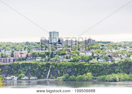 Cityscape or skyline of Levis town from plaines d'Abraham in summer in Quebec City Canada overlooking the Saint Lawrence river