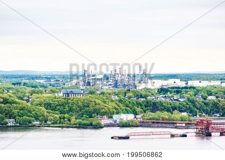 Cityscape or skyline of Levis town from plaines d'Abraham in summer in Quebec City Canada overlooking the Saint Lawrence river with oil refinery