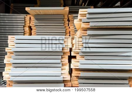 Stacks Of Wooden Furniture On Steel Racks