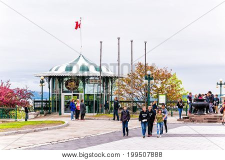 Quebec City Canada - May 30 2017: Old town view of Frontenac building gazebo gift shop and people on dufferin terrace