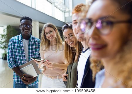 Group Of Happy Young Students Looking At Camera In A University.