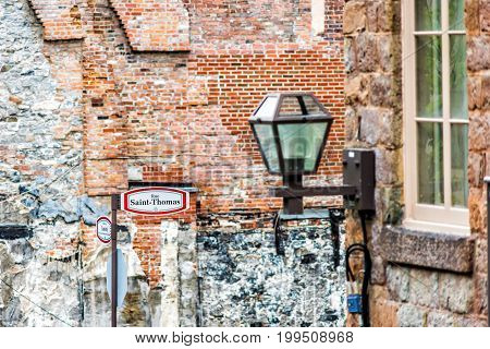 Closeup Of Upper And Lower Old Town Street Signs In Quebec City, Canada Called Rue Saint-thomas And