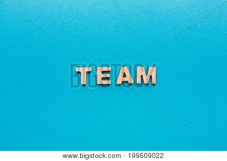 Word Team on blue background. Cooperation, togetherness, partnership concept