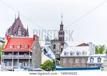 Quebec City Canada - May 30 2017: Old lower town area with cityscape view of Chateau Frontenac and colorful buildings