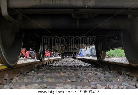 View of tracks under a train wagon
