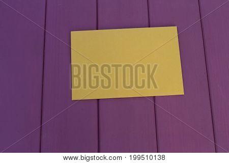 kraft paper envelope on a purple wooden background. Vintage style.