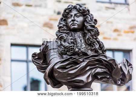 Quebec City Canada - May 30 2017: Lower old town street with statue Bust of Louis XIV closeup