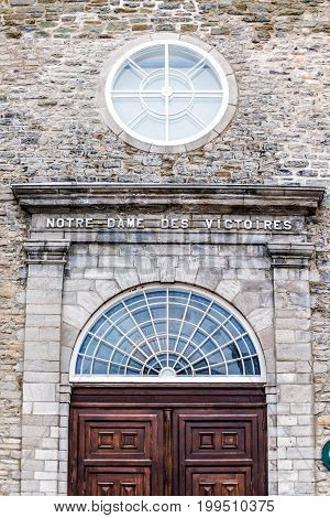 Quebec City Canada - May 30 2017: Lower old town street on la place Royale with Notre-Dame des Victoires church with wooden door entrance