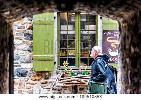 Quebec City Canada - May 30 2017: Lower old town with cobblestone street narrow alley called Passage De La Batterie with light lamp and man walking