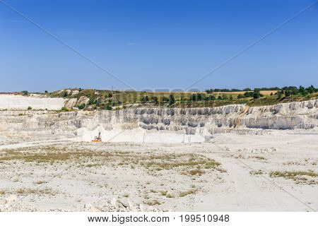 Limestone quarry, panoramic view of the limestone industry, white hills, blue sky